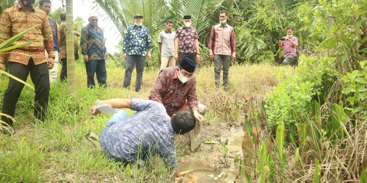 Bupati Tinjau Lahan warga yang terdampak Banjir di Desa arah Sialang