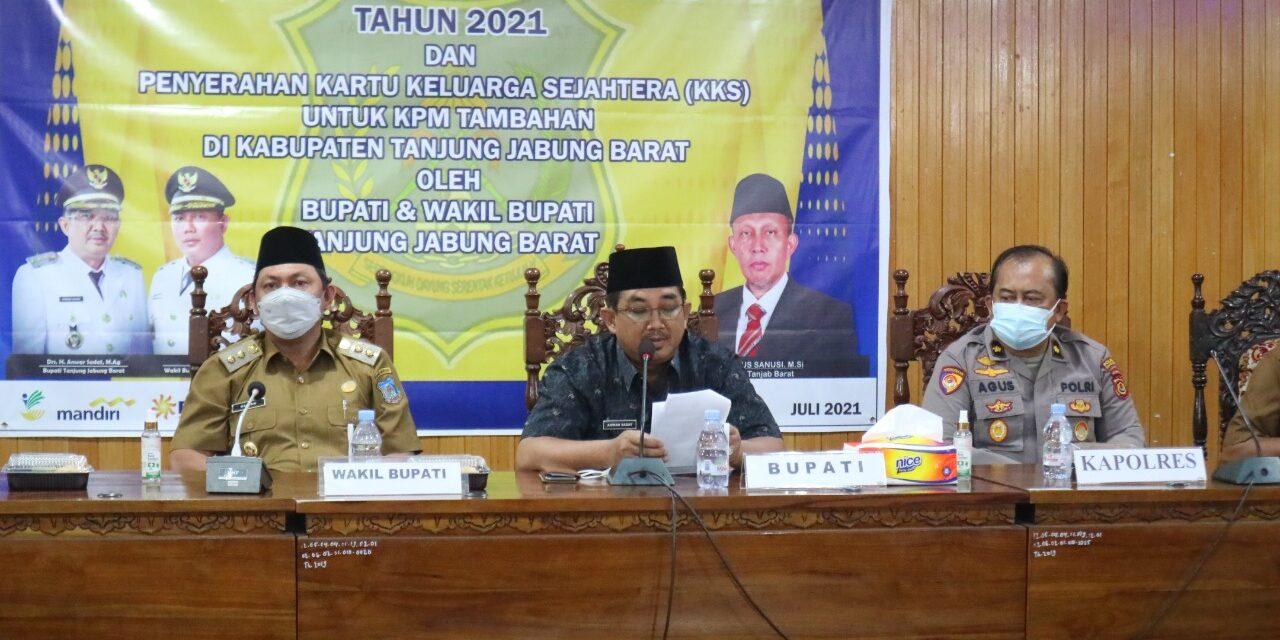 Hadiri Launching Program Sembako dan Penyerahan KKS 2021, Bupati Harap Bulog Serap Beras Petani Lokal Tanjab barat